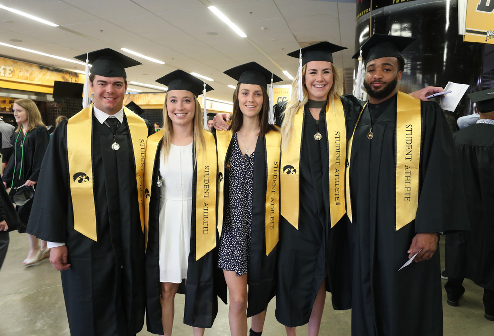 Iowa BaseballÕs Luke Farley, Field HockeyÕs Makenna Grewe and Isabella Brown, WomenÕs BasketballÕs Hannah Stewart and FotoballÕs Dominique Dafney during the College of Liberal Arts and Sciences spring commencement Saturday, May 11, 2019 at Carver-Hawkeye Arena. (Brian Ray/hawkeyesports.com)