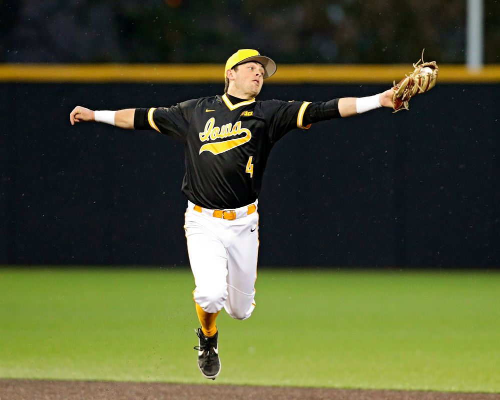 Iowa Hawkeyes shortstop Mitchell Boe (4) snags a throw during the ninth inning of their game against Illinois State at Duane Banks Field in Iowa City on Wednesday, Apr. 3, 2019. (Stephen Mally/hawkeyesports.com)