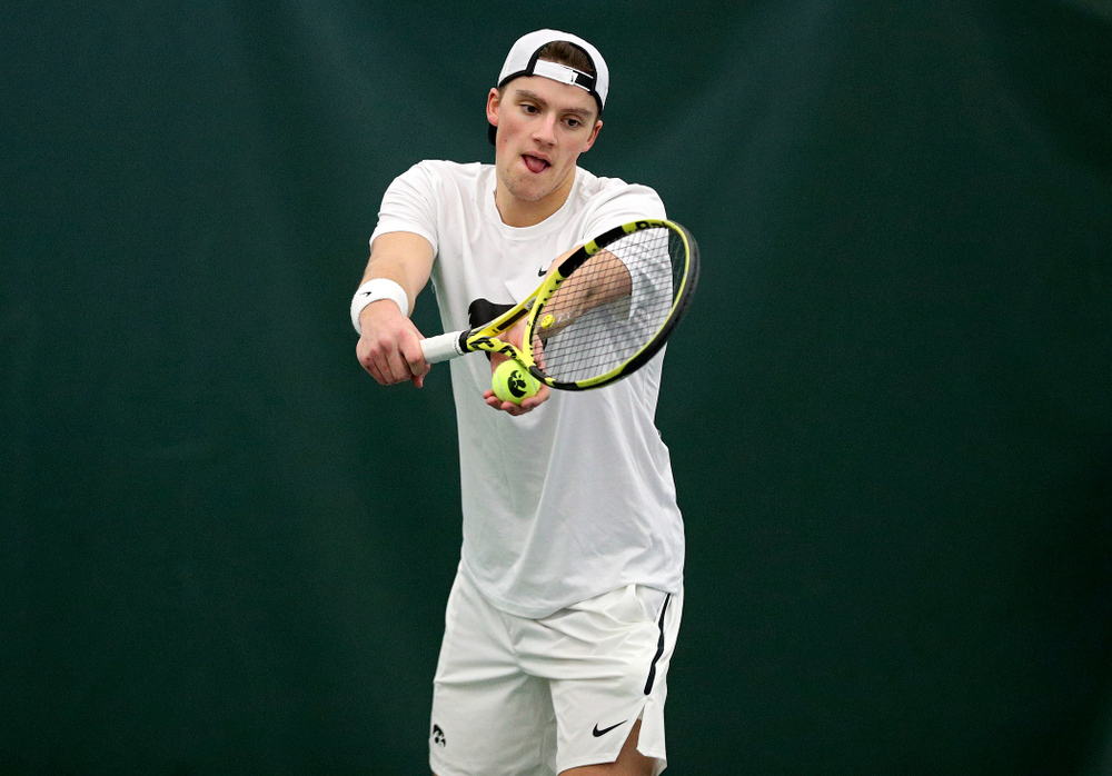 Iowa's Joe Tyler serves during his singles match at the Hawkeye Tennis and Recreation Complex in Iowa City on Sunday, February 16, 2020. (Stephen Mally/hawkeyesports.com)