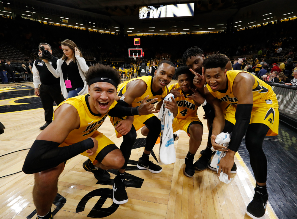 Iowa Hawkeyes forward Cordell Pemsl (35), guard Maishe Dailey (1), guard Isaiah Moss (4), forward Tyler Cook (5), and forward Ahmad Wagner (0)