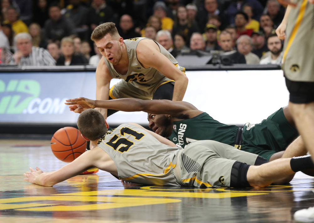 Iowa Hawkeyes guard Jordan Bohannon (3) and forward Nicholas Baer (51) against the Michigan State Spartans Thursday, January 24, 2019 at Carver-Hawkeye Arena. (Brian Ray/hawkeyesports.com)