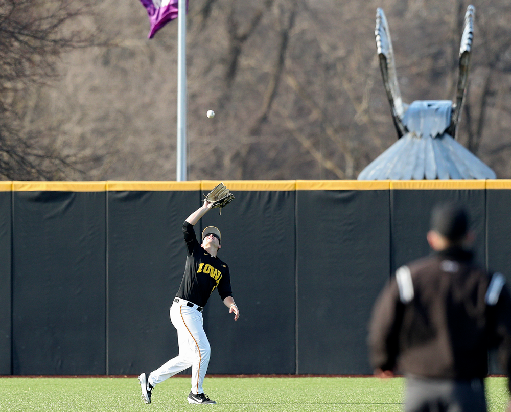 Iowa left fielder Zeb Adreon (5) pulls in a fly ball for an out during the third inning of their college baseball game at Duane Banks Field in Iowa City on Tuesday, March 10, 2020. (Stephen Mally/hawkeyesports.com)