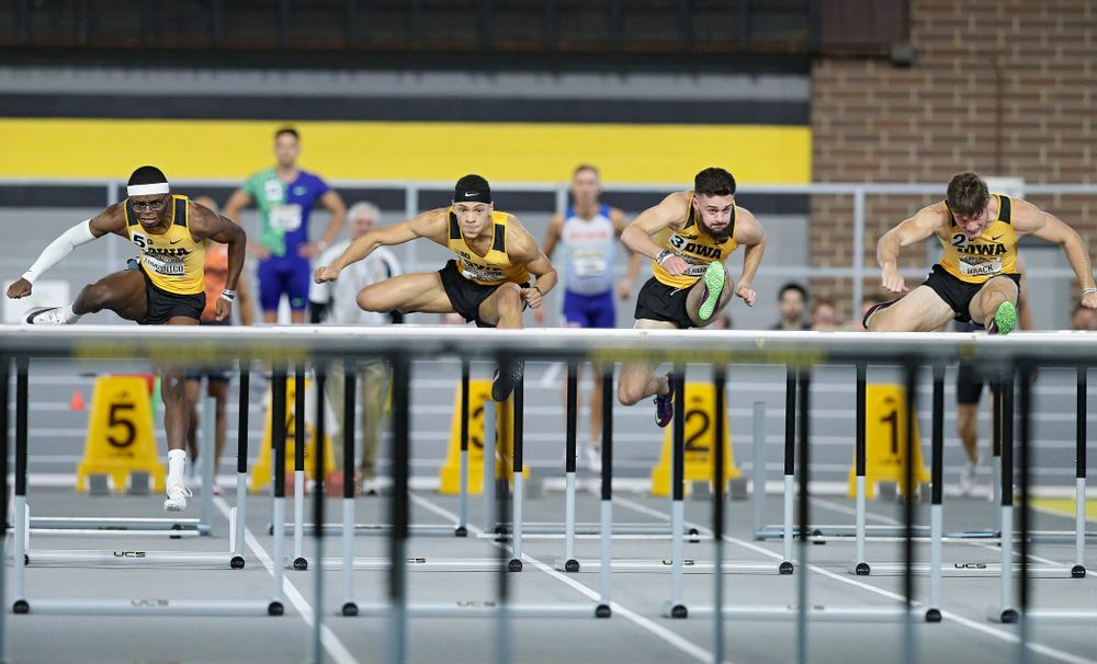 Iowa's Jaylan McConico (from left), Jamal Britt, Josh Braverman, and Peyton Haack run the men's 60 meter hurdles premier event during the Larry Wieczorek Invitational at the Recreation Building in Iowa City on Saturday, January 18, 2020. (Stephen Mally/hawkeyesports.com)
