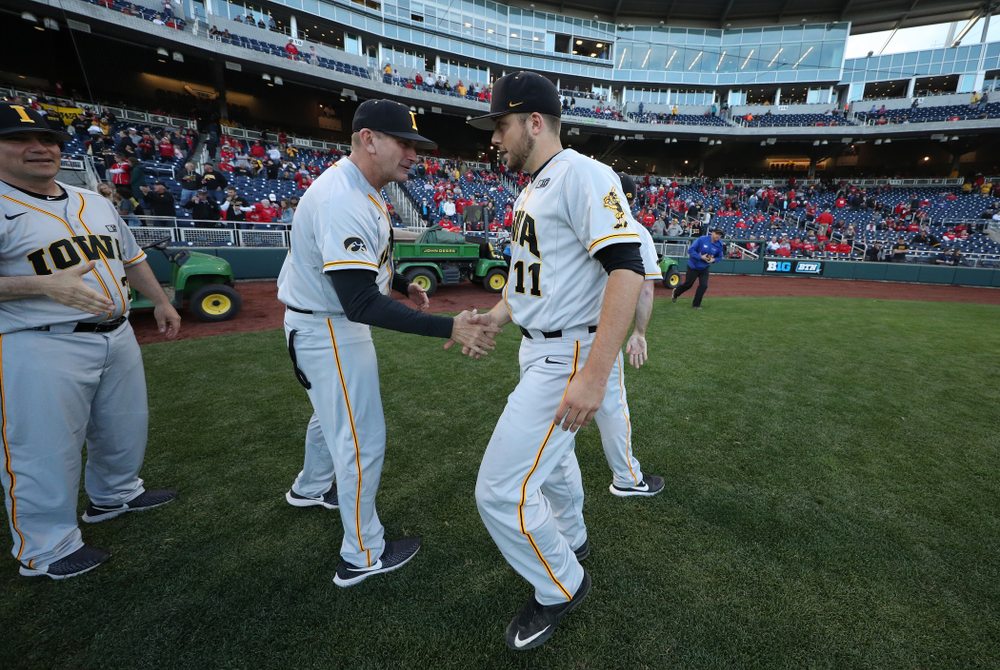 Iowa Hawkeyes head coach Rick Heller and Cole McDonald (11) against the Indiana Hoosiers in the first round of the Big Ten Baseball Tournament Wednesday, May 22, 2019 at TD Ameritrade Park in Omaha, Neb. (Brian Ray/hawkeyesports.com)