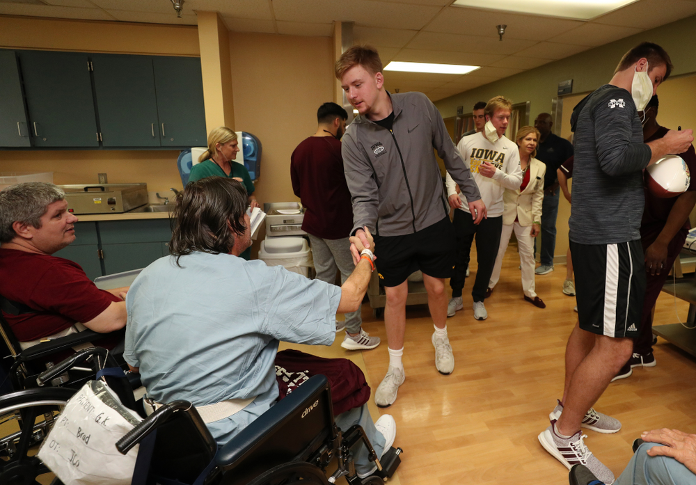 Iowa Hawkeyes quarterback Spencer Petras (7) shakes hands with a patient during a visit to Tampa General Hospital as part of the Outback Bowl Friday, December 28, 2018 in Tampa, FL.(Brian Ray/hawkeyesports.com)