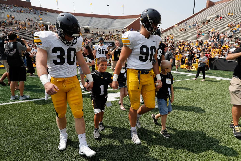 Iowa Hawkeyes defensive back Jake Gervase (30) and defensive end Sam Brincks (90) during Kids Day Saturday, August 11, 2018 at Kinnick Stadium. (Brian Ray/hawkeyesports.com)