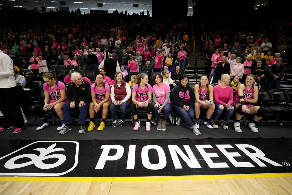 The Iowa Hawkeyes wait to be introduced by women affected by breast cancer before their game against the Wisconsin Badgers Sunday, February 16, 2020 at Carver-Hawkeye Arena. (Brian Ray/hawkeyesports.com)