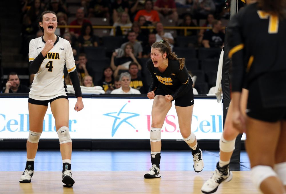 Iowa Hawkeyes defensive specialist Halle Johnston (4) and outside hitter Edina Schmidt (20) against the Iowa State Cyclones Saturday, September 21, 2019 at Carver-Hawkeye Arena. (Brian Ray/hawkeyesports.com)