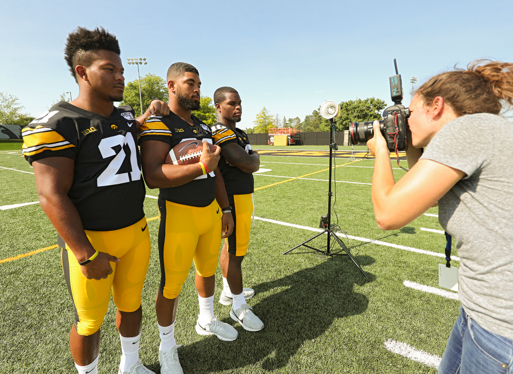 Iowa Hawkeyes running back Ivory Kelly-Martin (21), running back Toren Young (28), and running back Mekhi Sargent (10) pose for a picture during Iowa Football Media Day at the Hansen Football Performance Center in Iowa City on Friday, Aug 9, 2019. (Stephen Mally/hawkeyesports.com)
