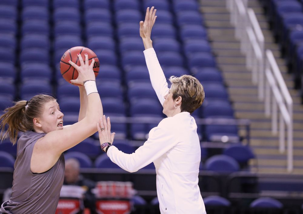 Iowa Hawkeyes center Monika Czinano (25) and associate head coach Jan Jensen during practice and media before the regional final of the 2019 NCAA Women's College Basketball Tournament against the Baylor Bears Sunday, March 31, 2019 at Greensboro Coliseum in Greensboro, NC.(Brian Ray/hawkeyesports.com)