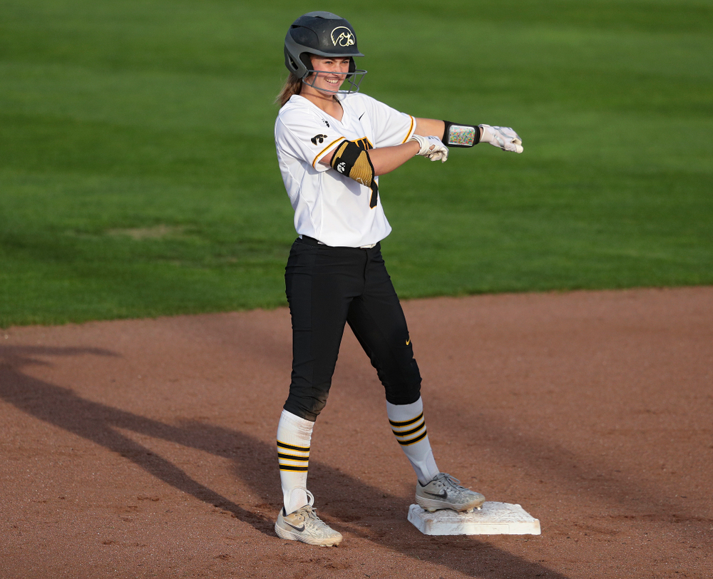 Iowa second baseman Aralee Bogar (2) dances on second base after hitting a double during the fifth inning of their game against Ohio State at Pearl Field in Iowa City on Friday, May. 3, 2019. (Stephen Mally/hawkeyesports.com)