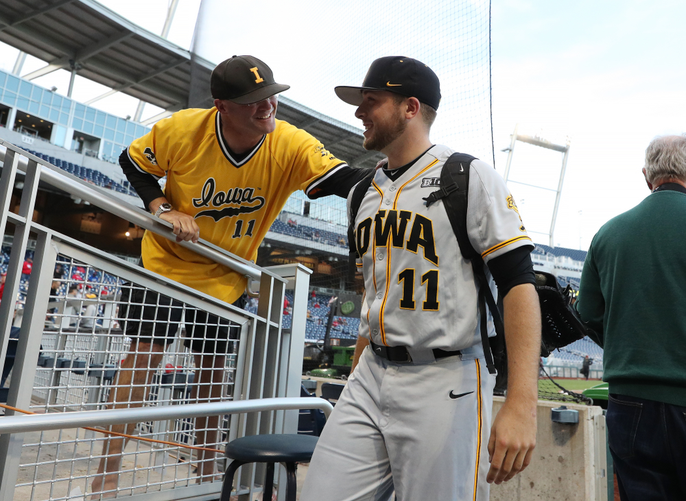 Iowa Hawkeyes Cole McDonald (11) hugs his father after getting the win against the Indiana Hoosiers in the first round of the Big Ten Baseball Tournament Wednesday, May 22, 2019 at TD Ameritrade Park in Omaha, Neb. (Brian Ray/hawkeyesports.com)