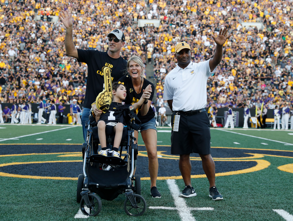 Kid Captain Quinn Stumpf and honorary captain Marvin Sims, Jr. against the Northern Iowa Panthers Saturday, September 15, 2018 at Kinnick Stadium. (Brian Ray/hawkeyesports.com)