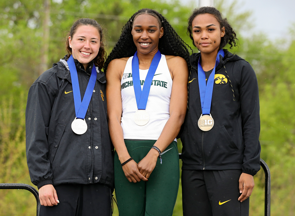 Iowa's Jenny Kimbro (left) and Tria Simmons (right) on the award stand after placing second and third in the heptathlon event on the second day of the Big Ten Outdoor Track and Field Championships at Francis X. Cretzmeyer Track in Iowa City on Saturday, May. 11, 2019. (Stephen Mally/hawkeyesports.com)