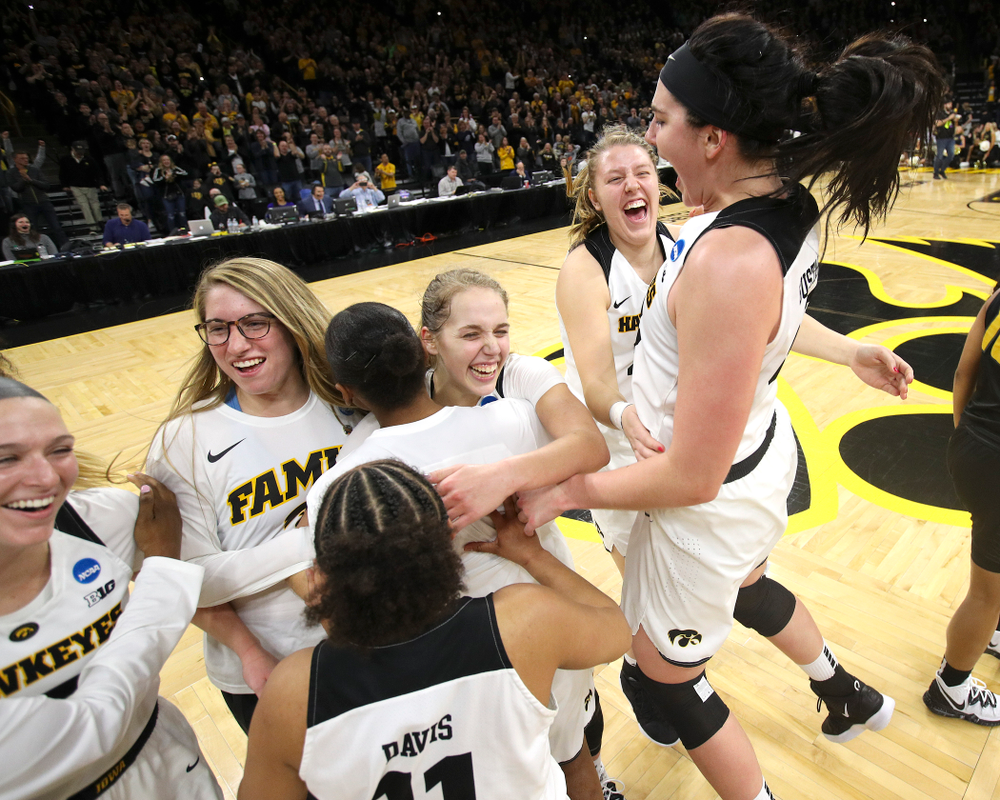 Iowa Hawkeyes center Megan Gustafson (10) jumps in the air as she celebrates with her teammates after winning their second round game in the 2019 NCAA Women's Basketball Tournament at Carver Hawkeye Arena in Iowa City on Sunday, Mar. 24, 2019. (Stephen Mally for hawkeyesports.com)