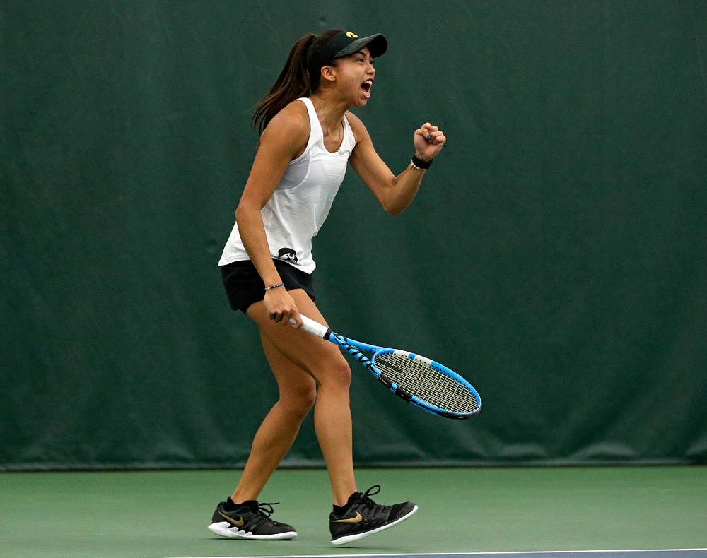 Iowa's Michelle Bacalla celebrates a point during her doubles match at the Hawkeye Tennis and Recreation Complex in Iowa City on Sunday, February 23, 2020. (Stephen Mally/hawkeyesports.com)