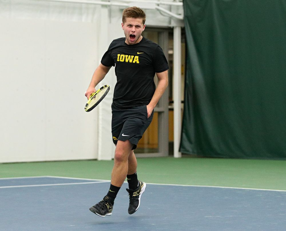 Iowa's Will Davies celebrates after a point during his singles match at the Hawkeye Tennis and Recreation Complex in Iowa City on Friday, February 14, 2020. (Stephen Mally/hawkeyesports.com)