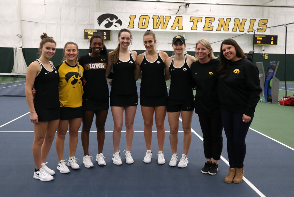 Academic Student Services Associate Director Kara Park and head coach Sash Schmid congratulate Danielle Burich, Adorabol Huckleby, Ashleigh Jacobs, Samantha Mannix, Cloe Ruette, and Elise Van Heuvelen for earning a 3.0 GPA or better during the fall semester before their match against the Penn State Nittany Lions Sunday, February 24, 2019 at the Hawkeye Tennis and Recreation Complex. (Brian Ray/hawkeyesports.com)