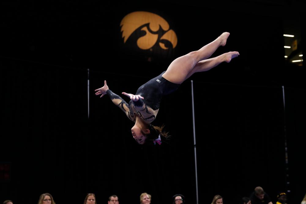 Iowa's Nicole Chow competes on the beam