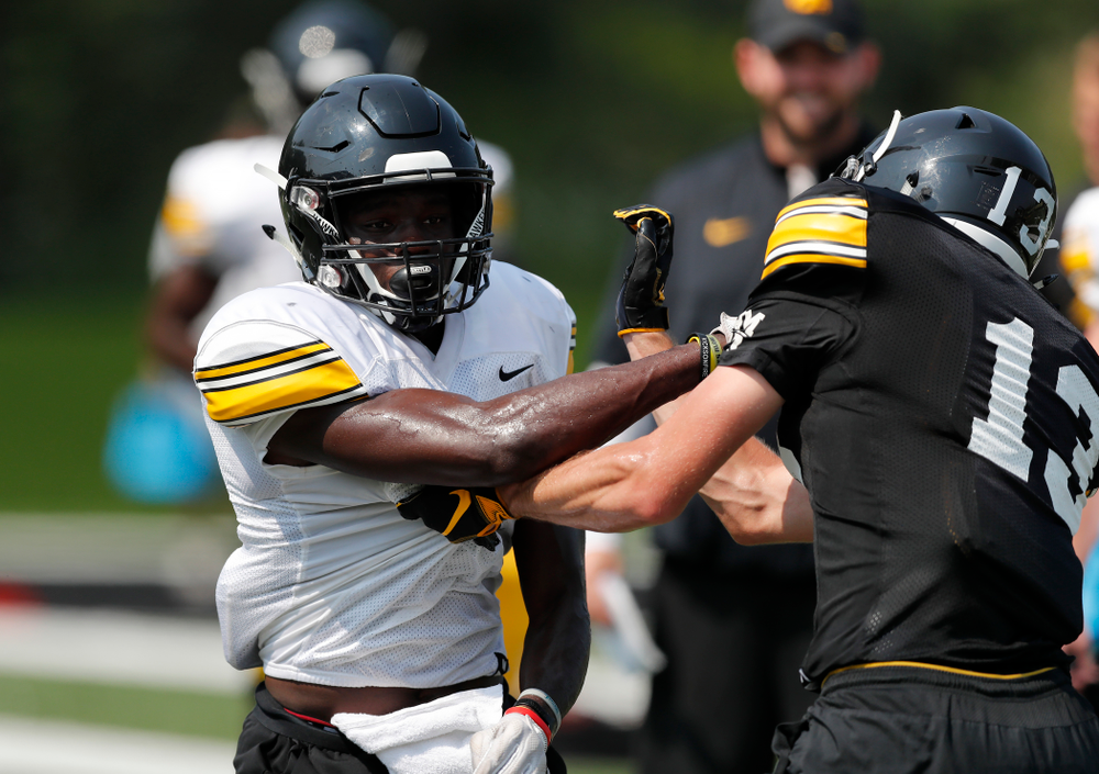 Iowa Hawkeyes defensive back Michael Ojemudia (11) during fall camp practice No. 9 Friday, August 10, 2018 at the Kenyon Practice Facility. (Brian Ray/hawkeyesports.com)