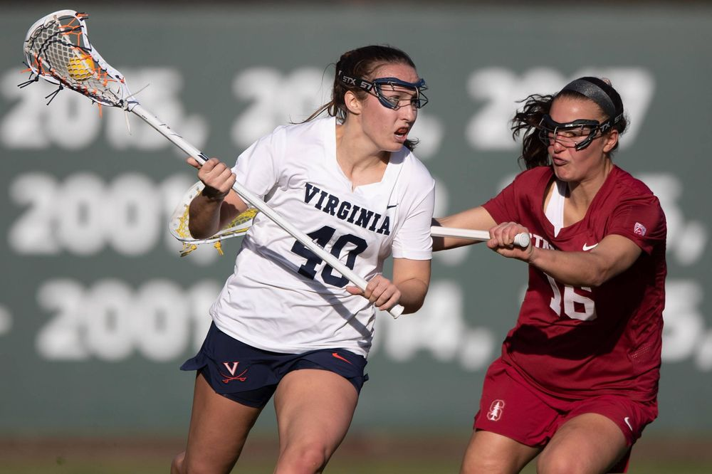 STANFORD, California - FEBRUARY 14:  Virginia Cavaliers attack Olivia Schildmeyer (40) is defended by Stanford Cardinal midfield Chelsea Trattner (16) during the first half at Cagan Stadium on February 14, 2020 in Stanford, California. The Virginia Cavaliers defeated the Stanford Cardinal 12-11. (Photo by Jason O. Watson)