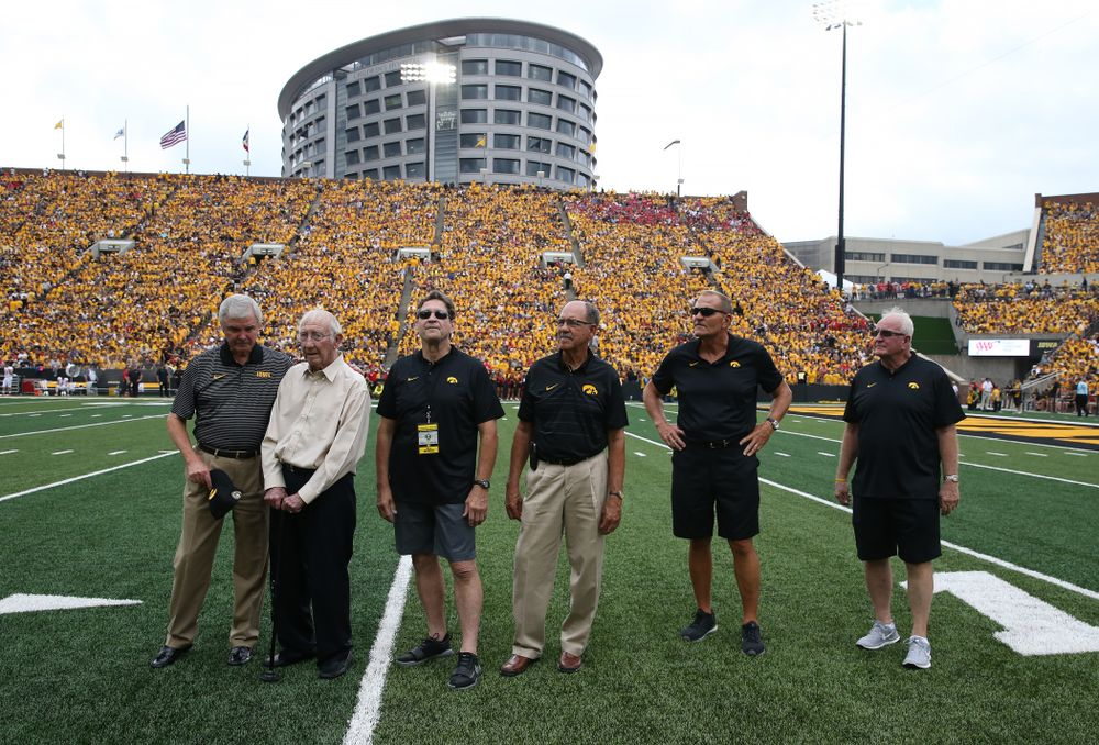 The 1983 Coaching Staff on the field against the Northern Illinois Huskies Saturday, September 1, 2018 at Kinnick Stadium. (Brian Ray/hawkeyesports.com)