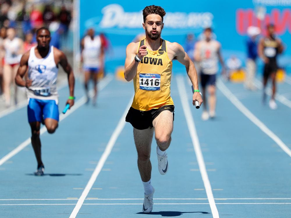 Iowa's Josh Braverman runs in the men's 400 meter relay event during the second day of the Drake Relays at Drake Stadium in Des Moines on Friday, Apr. 26, 2019. (Stephen Mally/hawkeyesports.com)
