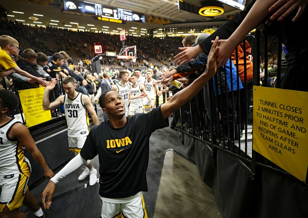Iowa Hawkeyes guard Bakari Evelyn (4) greets fans after winning their their game at Carver-Hawkeye Arena in Iowa City on Sunday, December 29, 2019. (Stephen Mally/hawkeyesports.com)