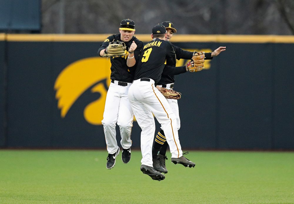 Iowa outfielders Zeb Adreon (5), Ben Norman (9), and Justin Jenkins (6) celebrate after winning their college baseball game at Duane Banks Field in Iowa City on Tuesday, March 10, 2020. (Stephen Mally/hawkeyesports.com)