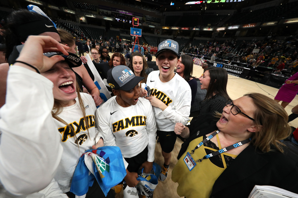 The Iowa Hawkeyes celebrate their victory over the Maryland Terrapins in the Big Ten Championship Game Sunday, March 10, 2019 at Bankers Life Fieldhouse in Indianapolis, Ind. (Brian Ray/hawkeyesports.com)