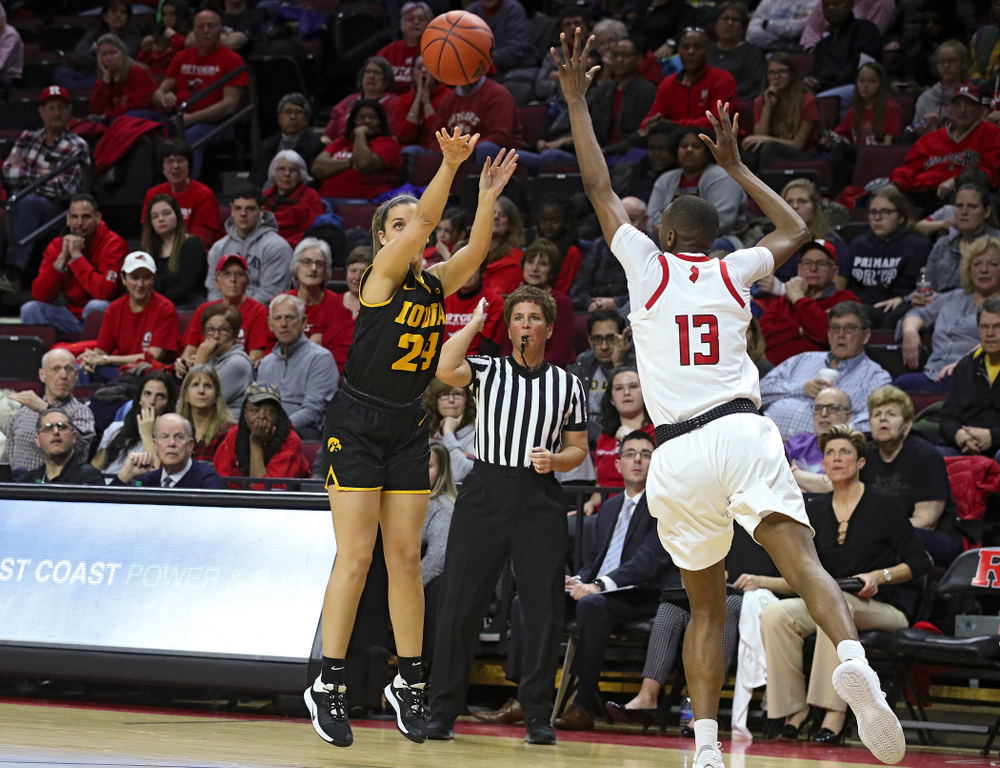 Iowa guard Gabbie Marshall (24) makes a 3-pointer during the third quarter of their game at the Rutgers Athletic Center in Piscataway, N.J. on Sunday, March 1, 2020. (Stephen Mally/hawkeyesports.com)