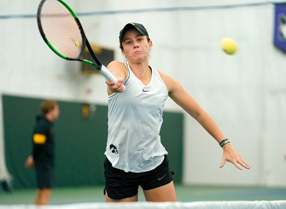 Iowa's Elise Van Heuvelen reaches for a shot during her doubles match at the Hawkeye Tennis and Recreation Complex in Iowa City on Sunday, February 16, 2020. (Stephen Mally/hawkeyesports.com)
