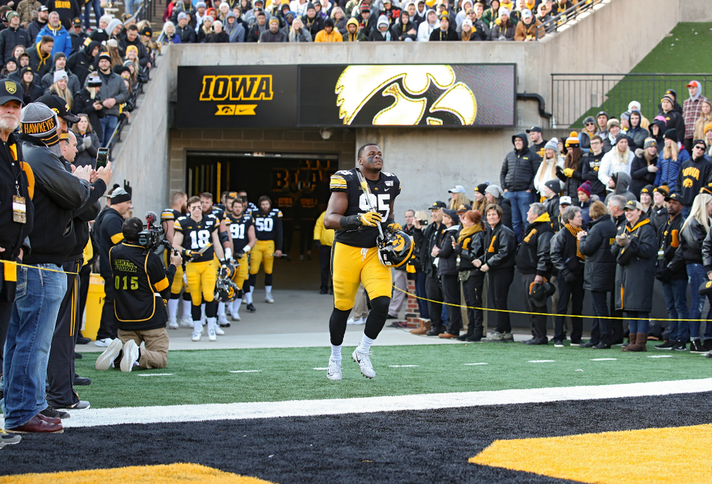 Iowa Hawkeyes defensive lineman Cedrick Lattimore (95) is acknowledged on senior day before their game at Kinnick Stadium in Iowa City on Saturday, Nov 23, 2019. (Stephen Mally/hawkeyesports.com)