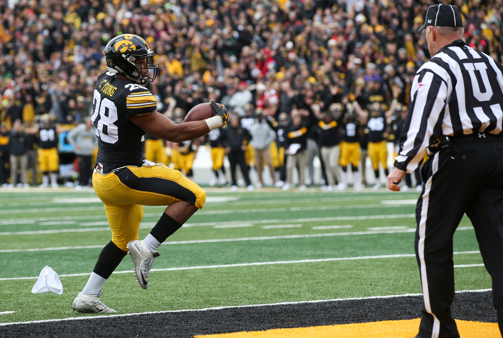 Iowa Hawkeyes running back Toren Young (28) runs the ball for a touchdown during a game against Nebraska at Kinnick Stadium on November 23, 2018. (Tork Mason/hawkeyesports.com)