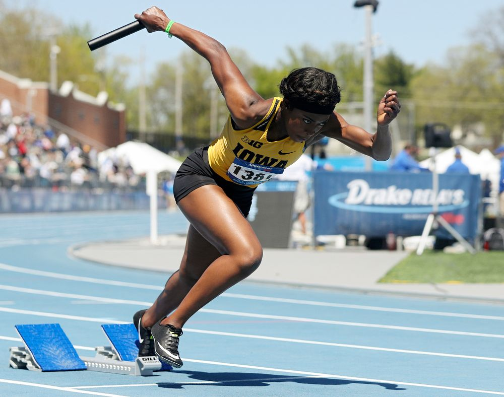 Iowa's Amanda Carty takes off out of the blocks in the women's 400 meter relay event during the second day of the Drake Relays at Drake Stadium in Des Moines on Friday, Apr. 26, 2019. (Stephen Mally/hawkeyesports.com)