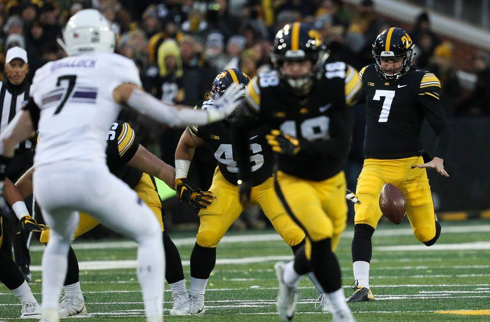 Iowa Hawkeyes punter Colten Rastetter (7) punts the ball during a game against Northwestern at Kinnick Stadium on November 10, 2018. (Tork Mason/hawkeyesports.com)