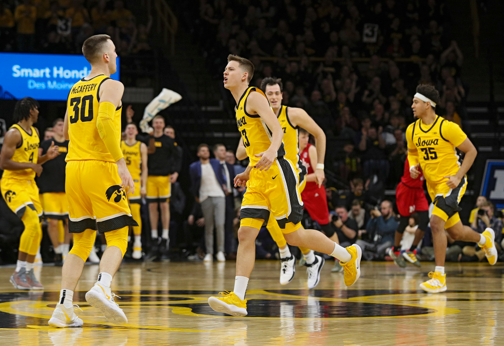 Iowa Hawkeyes guard Austin Ash (13) celebrates after making a 3-pointer during the second half of their game at Carver-Hawkeye Arena in Iowa City on Saturday, February 8, 2020. (Stephen Mally/hawkeyesports.com)