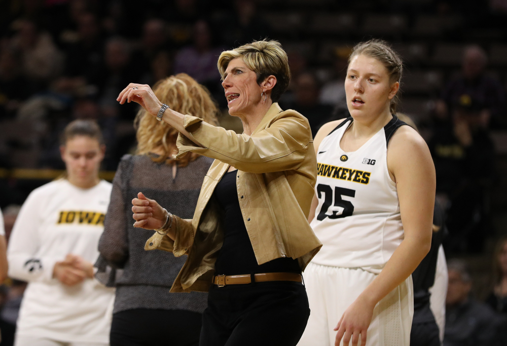 Associate head coach Jan Jensen  and forward/center Monika Czinano (25) against the Illinois Fighting Illini Thursday, February 14, 2019 at Carver-Hawkeye Arena. (Brian Ray/hawkeyesports.com)