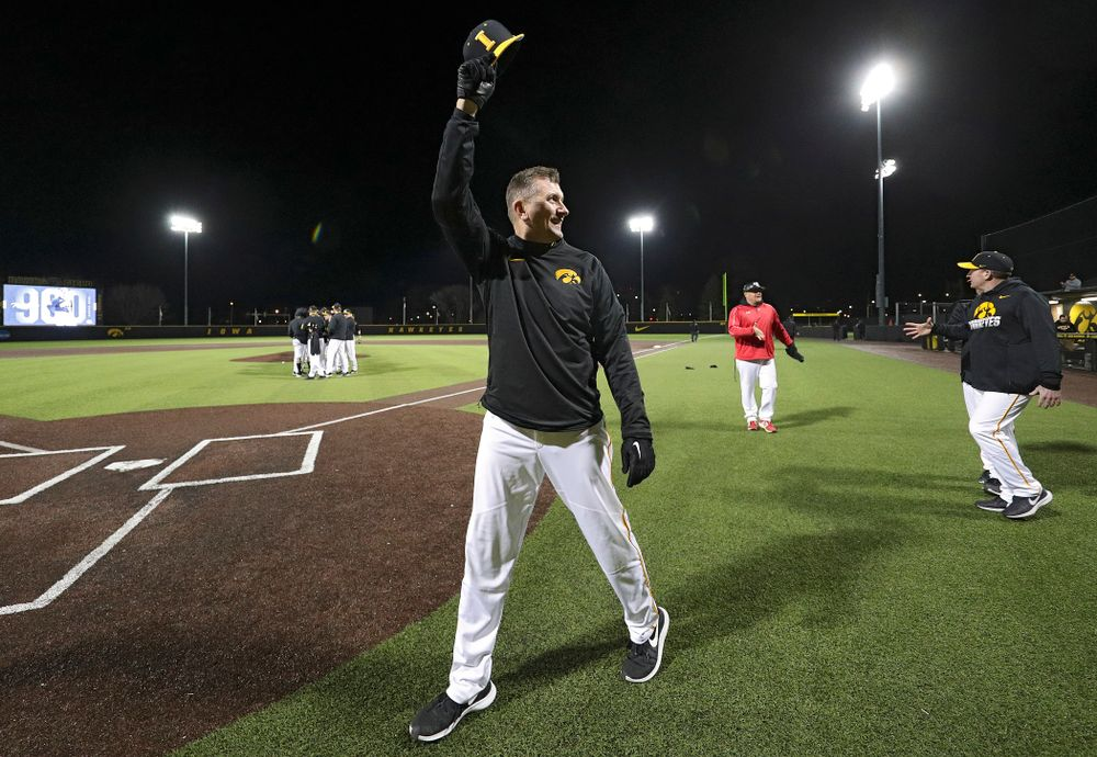 Iowa Hawkeyes head coach Rick Heller acknowledges the crowd after winning his 900th career game after their game at Duane Banks Field in Iowa City on Tuesday, March 3, 2020. (Stephen Mally/hawkeyesports.com)