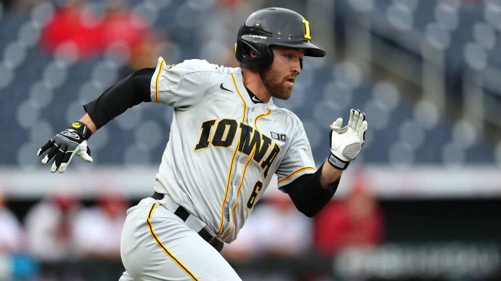 Iowa Hawkeyes outfielder Justin Jenkins (6) singles against the Indiana Hoosiers in the first round of the Big Ten Baseball Tournament Wednesday, May 22, 2019 at TD Ameritrade Park in Omaha, Neb. (Brian Ray/hawkeyesports.com)