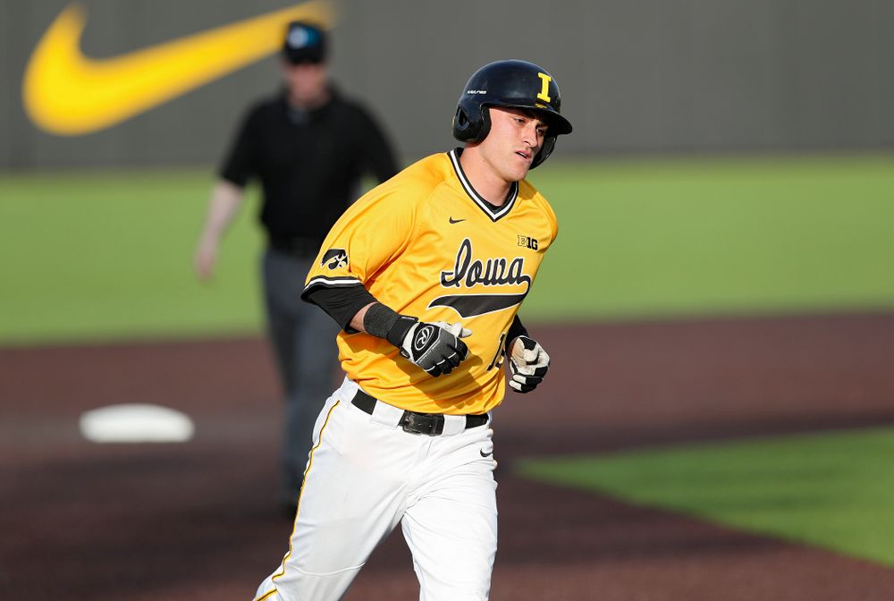 Iowa Hawkeyes shortstop Tanner Wetrich (16) rounds the bases after hitting a home run during the fifth inning of their game against Northern Illinois at Duane Banks Field in Iowa City on Tuesday, Apr. 16, 2019. (Stephen Mally/hawkeyesports.com)