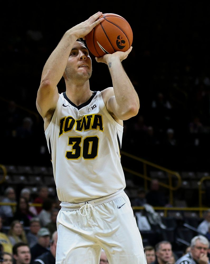 Iowa Hawkeyes guard Connor McCaffery (30) puts up a 3-pointer during a game against Guilford College at Carver-Hawkeye Arena on November 4, 2018. (Tork Mason/hawkeyesports.com)