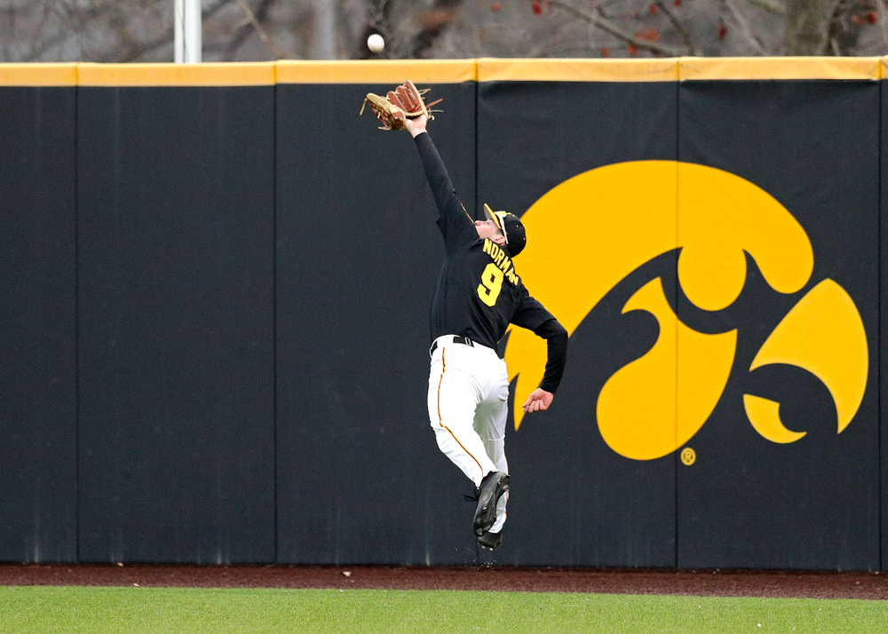 Iowa outfielder Ben Norman (9) makes a running catch for an out during the ninth inning of their college baseball game at Duane Banks Field in Iowa City on Tuesday, March 10, 2020. (Stephen Mally/hawkeyesports.com)