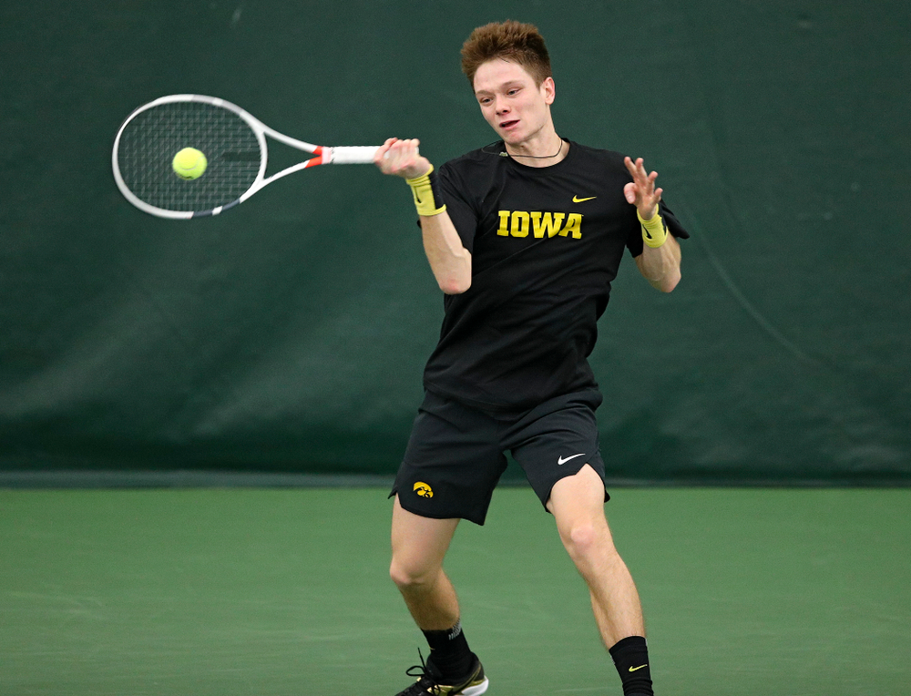 Iowa's Jason Kerst returns a shot during their match at the Hawkeye Tennis and Recreation Complex in Iowa City on Thursday, January 16, 2020. (Stephen Mally/hawkeyesports.com)