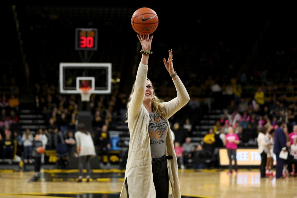 Former player Nicole Smith shoots free throws during the Iowa Hawkeyes game against the Wisconsin Badgers Sunday, February 16, 2020 at Carver-Hawkeye Arena. (Brian Ray/hawkeyesports.com)