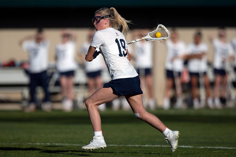 STANFORD, California - FEBRUARY 14:  Virginia Cavaliers midfield Annie Dyson (19) shoots against the Stanford Cardinal during the first half at Cagan Stadium on February 14, 2020 in Stanford, California. The Virginia Cavaliers defeated the Stanford Cardinal 12-11. (Photo by Jason O. Watson)