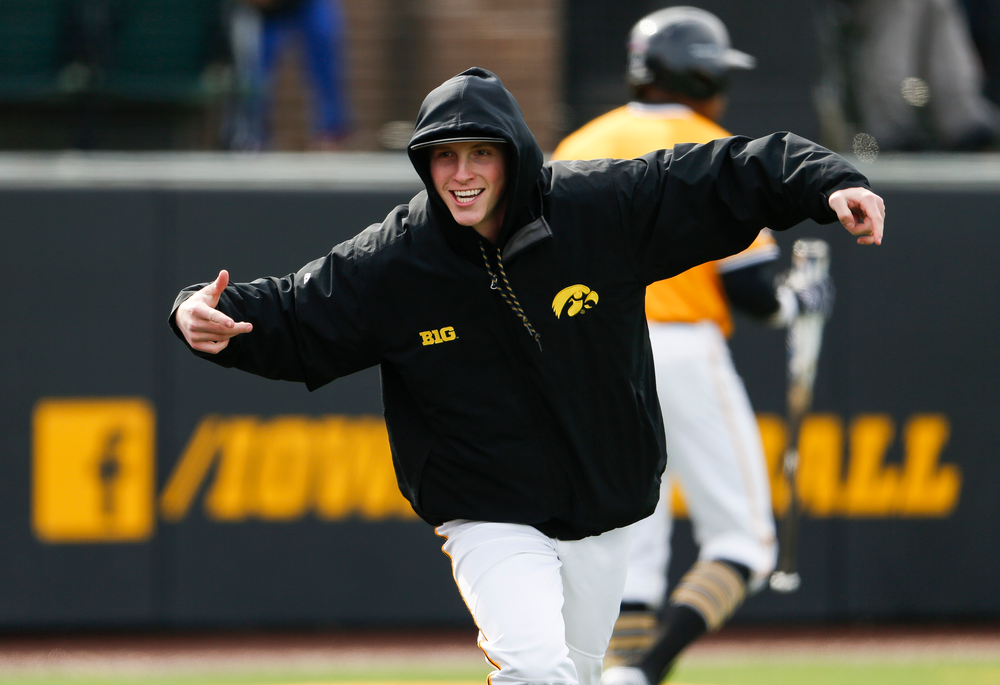 Iowa Hawkeyes pitcher Shane Ritter (18) reacts after the Hawkeyes take a 3-2 eighth inning lead during a game against Evansville at Duane Banks Field on March 18, 2018. (Tork Mason/hawkeyesports.com)