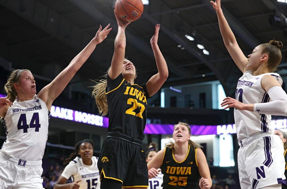 Iowa Hawkeyes guard Kathleen Doyle (22) scores a basket during the third quarter of their game at Welsh-Ryan Arena in Evanston, Ill. on Sunday, January 5, 2020. (Stephen Mally/hawkeyesports.com)