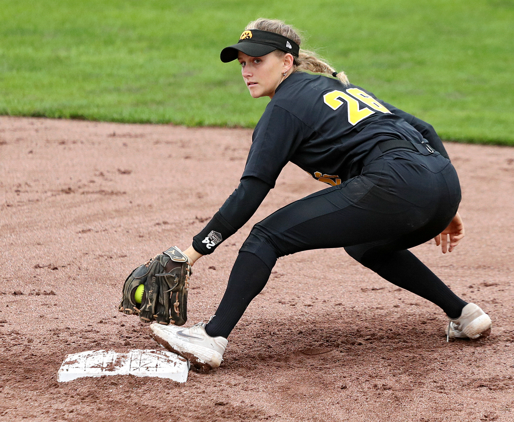 Iowa infielder Mia Ruther (26) eyes the runner after snagging a throw during the fifth inning of their game against Iowa Softball vs Indian Hills Community College at Pearl Field in Iowa City on Sunday, Oct 6, 2019. (Stephen Mally/hawkeyesports.com)