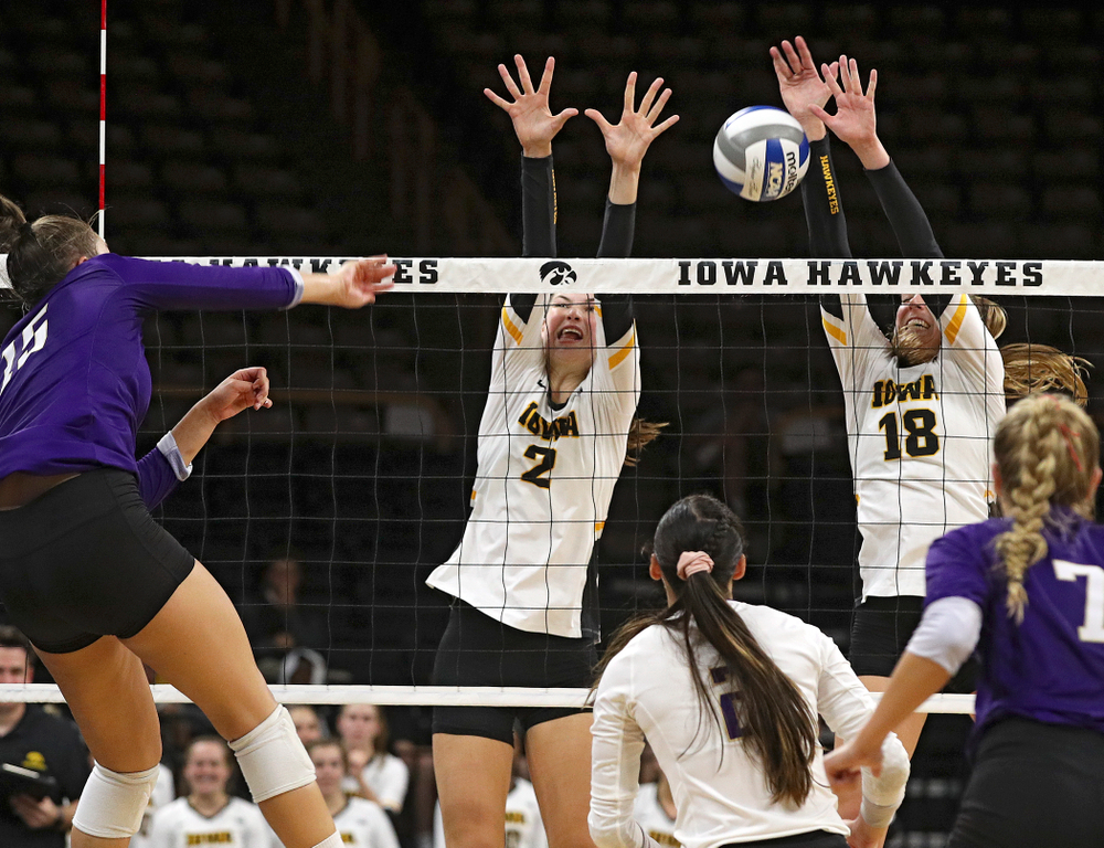 Iowa's Hannah Clayton (18) gets a block as Courtney Buzzerio (2) looks on during their Big Ten/Pac-12 Challenge match at Carver-Hawkeye Arena in Iowa City on Saturday, Sep 7, 2019. (Stephen Mally/hawkeyesports.com)